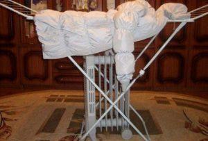 Как сушить пуховик после стирки в домашних условиях – проверенные способы